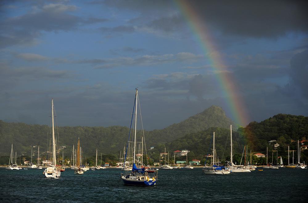Grenada Rainbow over Yachts moored in Tyrrel Bay, Carriacou