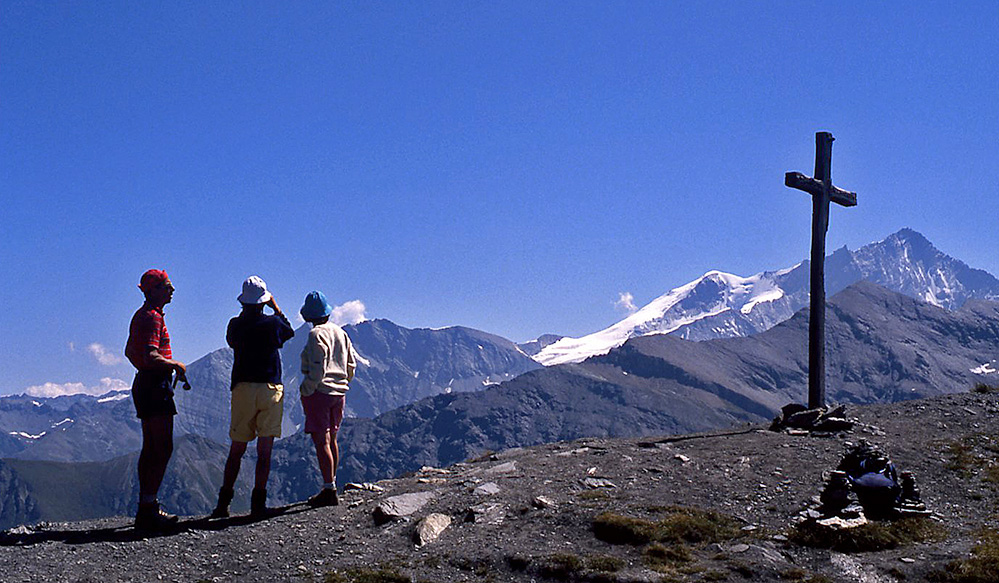 Walkers and view to Weisshorn, Swiss Alps