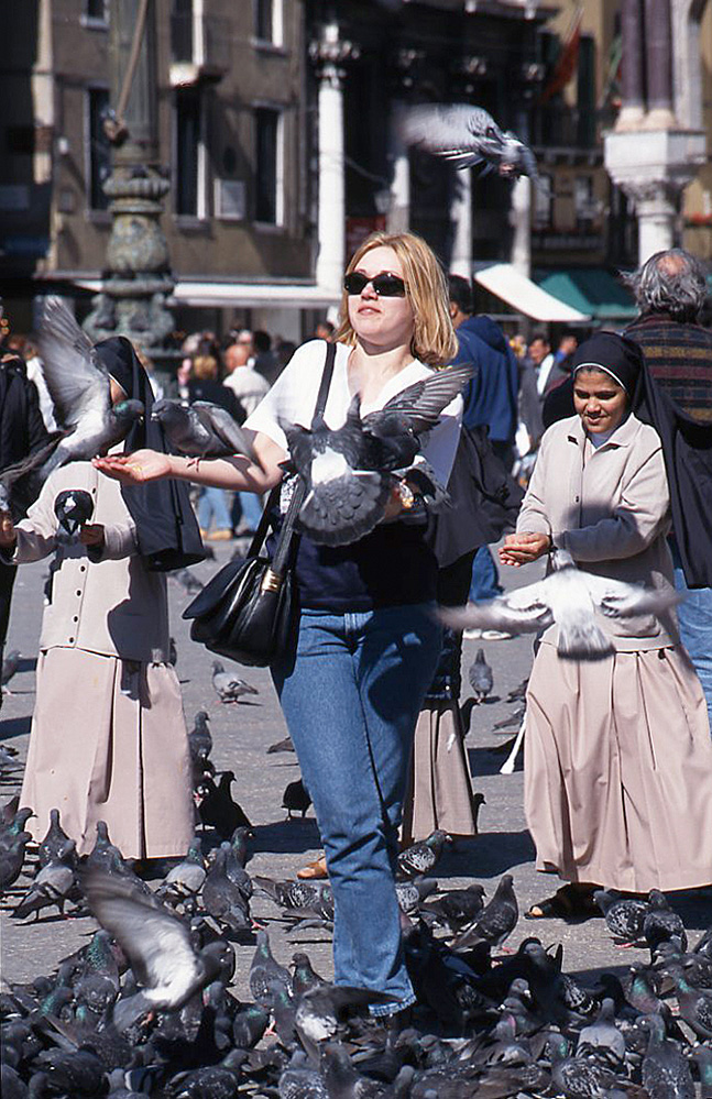 Girl and Pigeons in Piazza San Marco